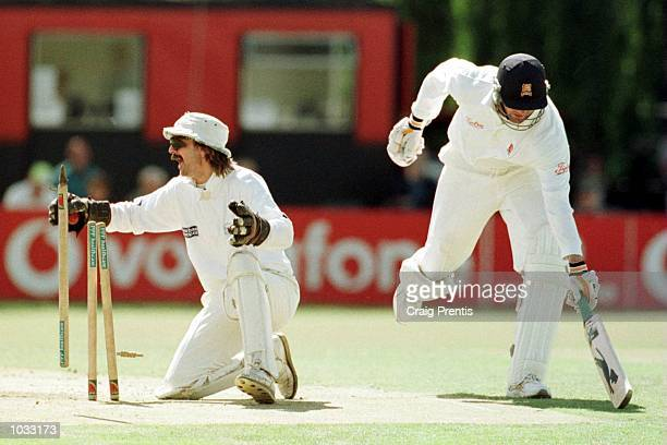 Jack Russell of Gloucestershire tries unsuccessfully to run out Ronnie Irani of Essex on the final day of the PPP Healthcare Division Two County...