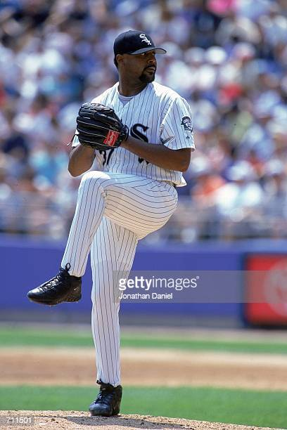 James Baldwin of the Chicago White Sox winds back to pitch the ball during a game against the Oakland Athletics at Comiskey Park in Chicago Illinois...