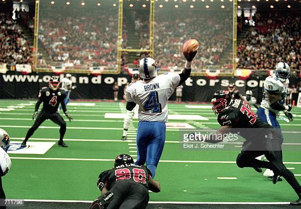 James Brown of the Nashville Kats passes the ball down field during the Arena Bowl Game against the Orlando Predators at the TD Waterhouse Centre in...