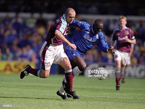 Javier Margas of West Ham United tussles with Jimmy Floyd Hasselbaink of Chelsea during the FA Carling Premiership match at Stamford Bridge in London...