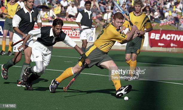 Jay Stacey#13 smidfielder forAustralia moves the ball from Tariq Imran for Pakistan during the 3rd test match between Australia and Pakistanat the...