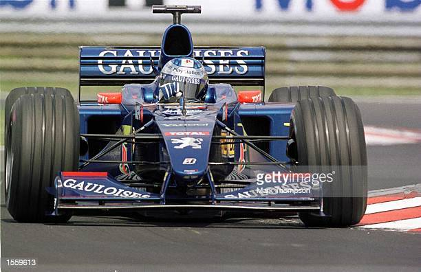 Jean Alesi of France and Prost Peugeot during the second free practice session for the Hungarian Grand Prix at Budapest Hungary Mandatory Credit Mark...