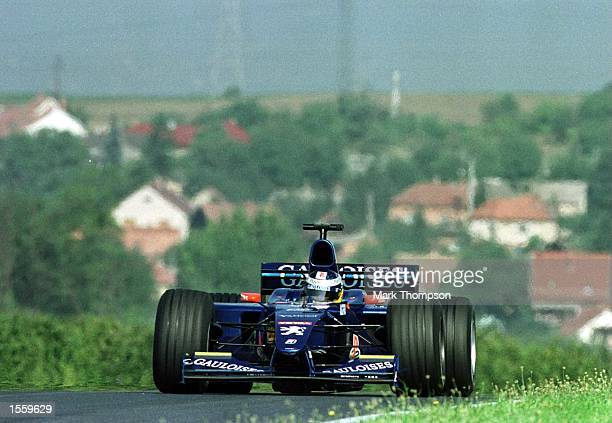 Jean Alesi of France and Prost Peugeot during the third free practice session for the Hungarian Grand Prix at Budapest Hungary Mandatory Credit Mark...