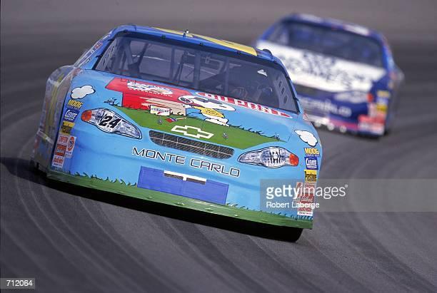 Jeff Gordon who drives the Chevrolet Monte Carlo for Hendricks Motorsports speeds around the corner during the Brickyard 400 Part of the NASCAR...