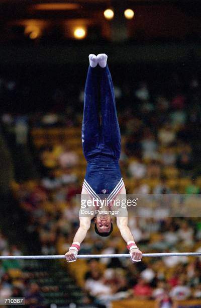 John Roethlisberger performs his routine in the Mens Horizontal Bar Event during the US Olympic Men's Gymnastics Trials at the Fleet Center in Boston...