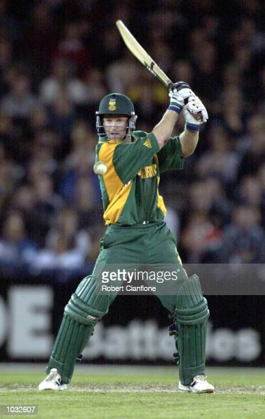 Jonty Rhodes of South Africa hits one away in the match between Australia and South Africa in game two of the Super Challenge 2000 played at the...