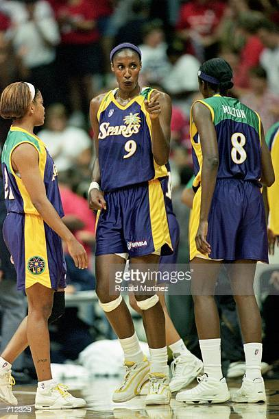 Lisa Leslie of the Los Angeles Sparks walks on the court as she points during a game against the Houston Comets at the Compaq Center in Houston Texas...