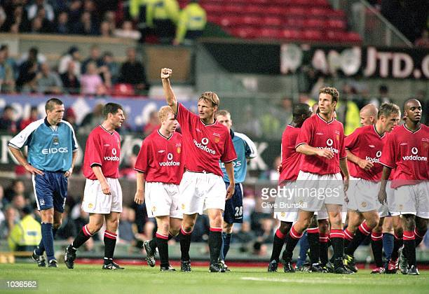 Manchester United celebrate during the Denis Irwin Testimonial match against Manchester City at Old Trafford in Manchester England Manchester United...