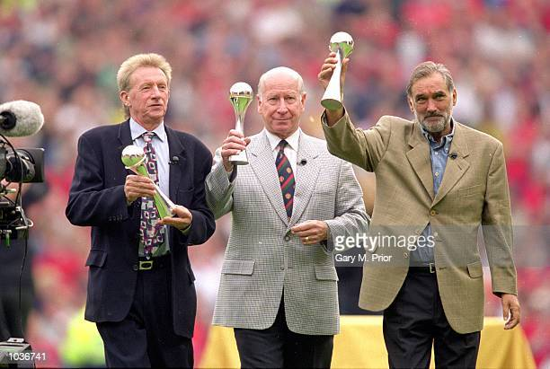 Manchester United legends Denis Law Bobby Charlton and George Best receive lifetime achievement awards as part of the National Footbal Awards during...