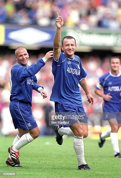 Mario Stanic of Chelsea celebrates a goal with team mate Jody Morris during the FA Carling Premiership match against West Ham United at Stamford...