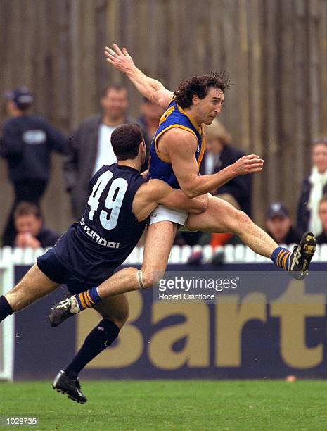Mark Passador for Carlton fails to stop Troy West for Williamstown from getting his kick away during the second semi final of the VFL season played...