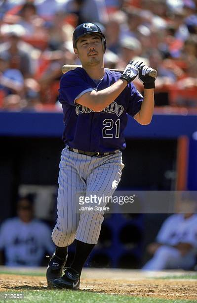 Masato Yoshii of the Colorado Rockies swings at the pitch during the game against the New York Mets at Shea Stadium in Flushing New York The Mets...