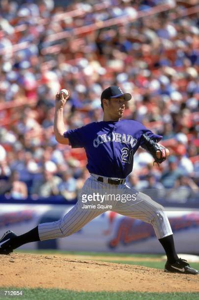 Masato Yoshii of the Colorado Rockies winds back to pitch the ball during the game against the New York Mets at Shea Stadium in Flushing New York The...