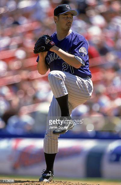 Masato Yoshii of the Colorado Rockies winds up to pitch the ball during the game against the New York Mets at Shea Stadium in Flushing New York The...