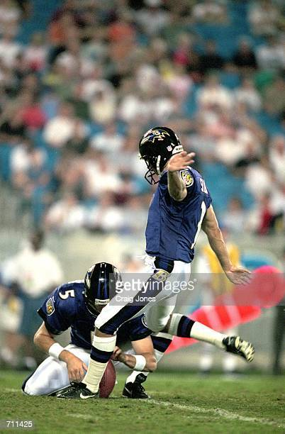 Matt Stover of the Baltimore Ravens moves to kick the ball during the Pre-Season game against the Carolina Panthers at Ericsson Stadium in Charlotte,...