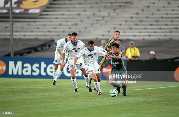d2daf240ab3 Mauricio Cienfuegos of the Los Angeles Galaxy moves with the ball as Preki  and Matt McKeon
