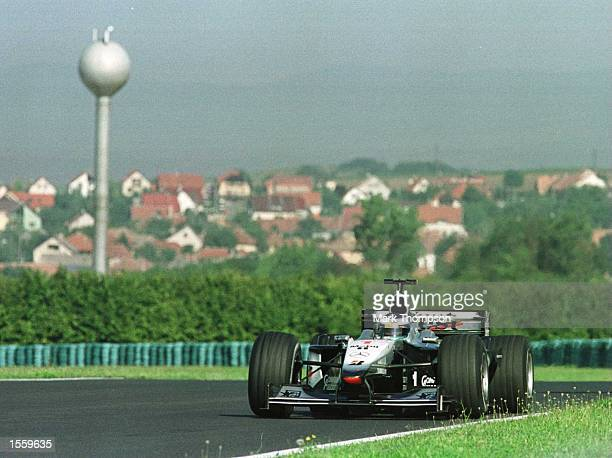 Mika Hakkinen of Finland and McLaren during the third free practice session for the Hungarian Grand Prix at Budapest Hungary Mandatory Credit Mark...