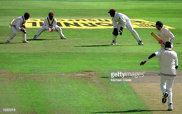 Mike Atherton of England is caught behind by Brian Lara for Curtly Ambrose's 400th wicket during the first day of the England v West Indies Fourth...
