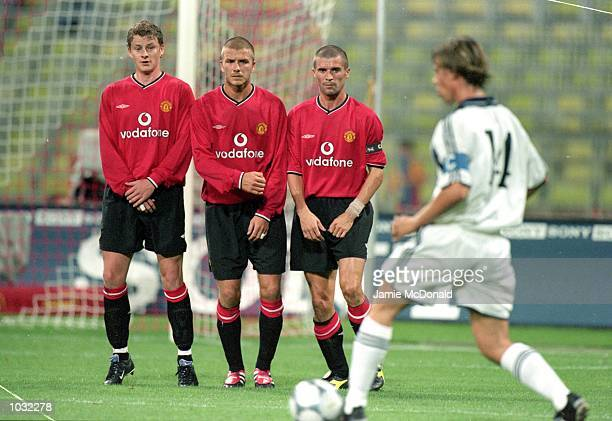 Ole Gunnar Solskjaer David Beckham and Roy Keane line up in the Manchester United wall as Guti of Real Madrid takes a freekick during the preseason...