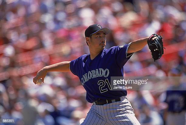 Pitcher Masato Yoshii of the Colorado Rockies winds back for the pitch during the game against the New York Mets Shea Stadiumin Flushing New York The...