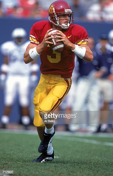 Quarterback Carson Palmer of the USC Trojans looks to pass the ball during the Kickoff Classic Game against the Penn State Nittany Lions at the...