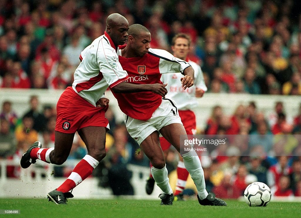 Richard Rufus of Charlton tries to tackle Thierry Henry of Arsenal during the FA Caling Premiership game between Arsenal and Charlton Athletic at Highbury, London. Mandatory Credit: Mike Hewitt/ALLSPORT