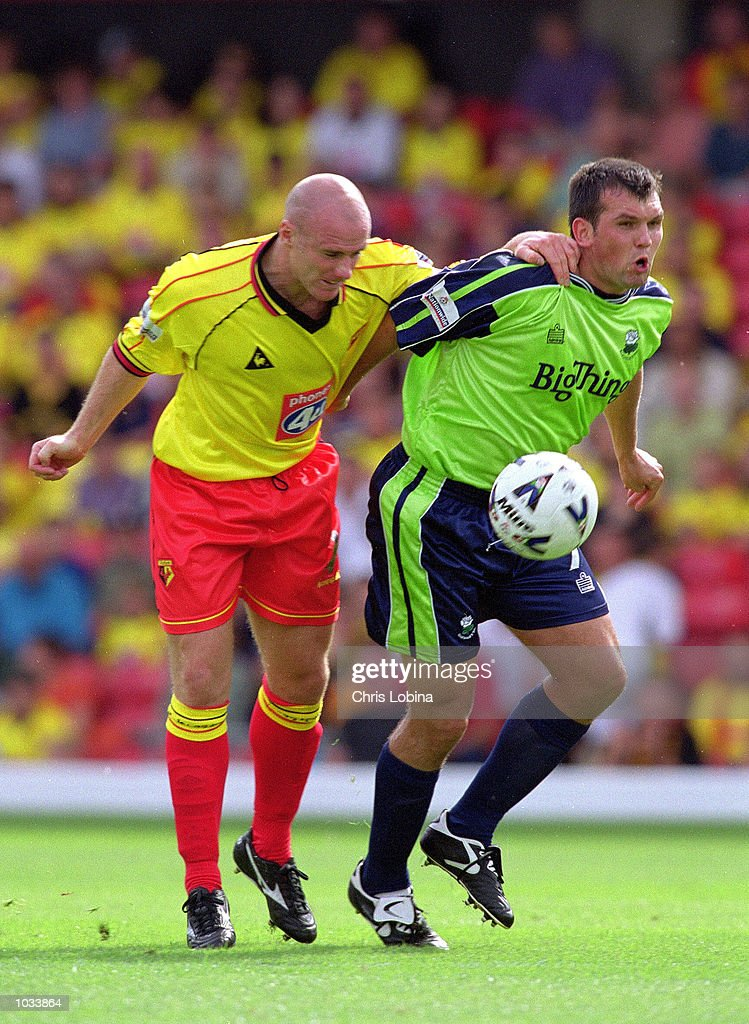 Robert Page of Watford tries the Vulcan Death Grip on Neil Shipperley of Barnsley during the Nationwide League Division One match at Vicarage Road in Watford, England. Watford won 1-0. \ Mandatory Credit: Chris Lobina /Allsport