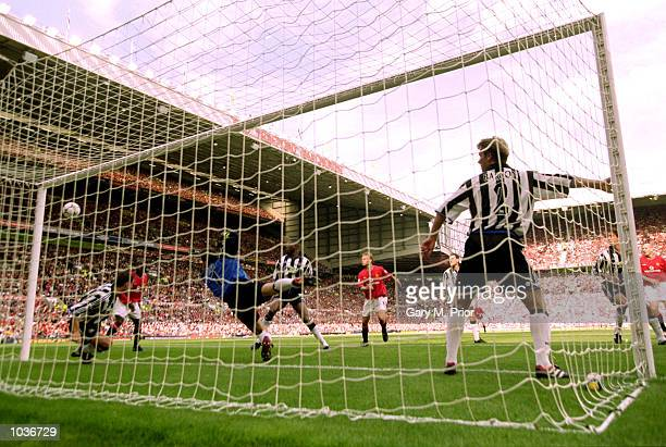 Ronny Johnsen of Manchester United heads past Shay Given in the Newcastle United goal to score the opening goal in the FA Carling Premiership match...