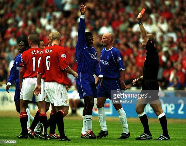 Roy Keane of Manchester United recives the red card form Referee M.Riley during the match between Chelsea and Manchester United in the One 2 One FA...