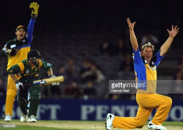 Shane Warne of Australia appeals unsuccessfully with Adam Gilchrist for the wicket of Jonty Rhodes of South Africa in the match between Australia and...
