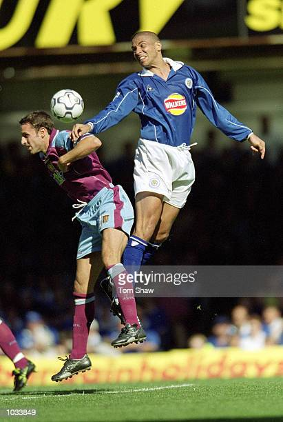 Stan Collymore of Leicester City rises above Gareth Southgate of Aston Villa during the FA Carling Premiership match at Filbert Street in Leicester...