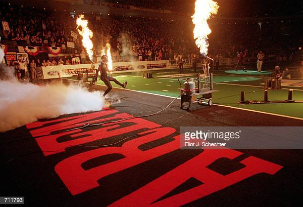 The Orlando Predators run onto the smoke covered field during the Arena Bowl Game against the Nashville Kats at the TD Waterhouse Centre in Orlando...