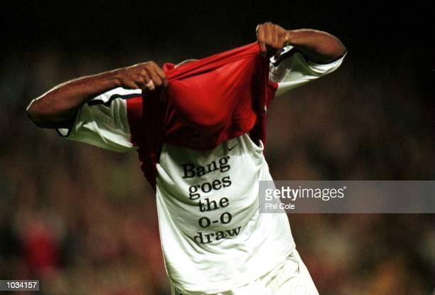 Thierry Henry of Arsenal celebrates his goal by showing off his tshirt during the match between Arsenal and Liverpool in the FA Carling Premiership...