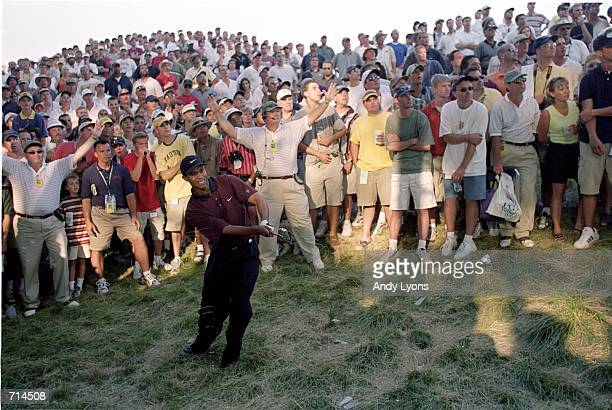 Tiger Woods chips out of the rough as spectators watch during the PGA Championship part of the PGA Tour at the Valhalla Golf Club in Louisville...