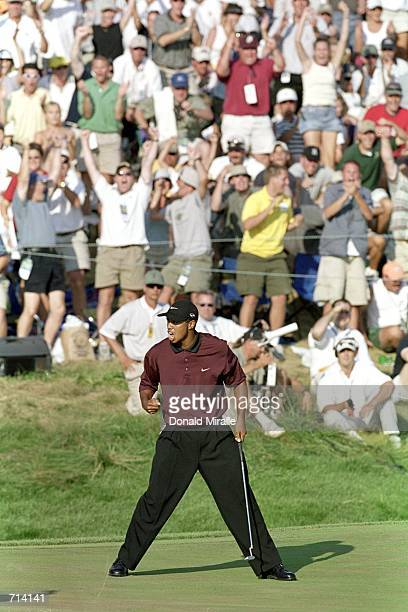 Tiger Woods reacts to the putts on the 18th hole to go to playoffs during the PGA Championship part of the PGA Tour at the Valhalla Golf Club in...