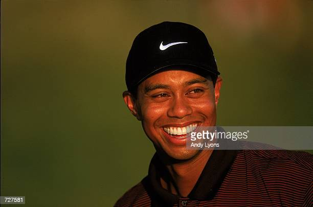 Tiger Woods smiles as he looks on during the PGA Championship part of the PGA Tour at the Valhalla Golf Club in Louisville KentuckyMandatory Credit...
