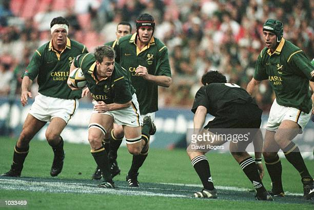 Robbie Fleck the Springbok centre charges forward with the ball during the Tri Nation Rugby Union International between South Africa and New Zealand...