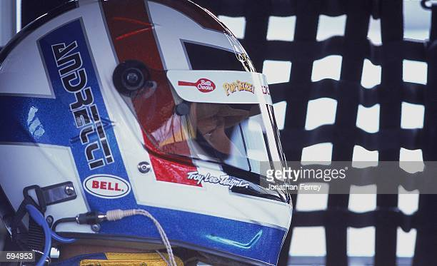 A close up of John Andretti who drives the Dodge Intrepid for Petty Enterprises as he looks on from his car during the Global Crossing part of the...