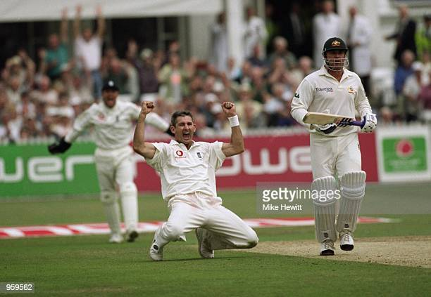 A delighted Andrew Caddick of England celebrates getting the wicket of Shane Warne during the Third Ashes Test match between England and Australia...