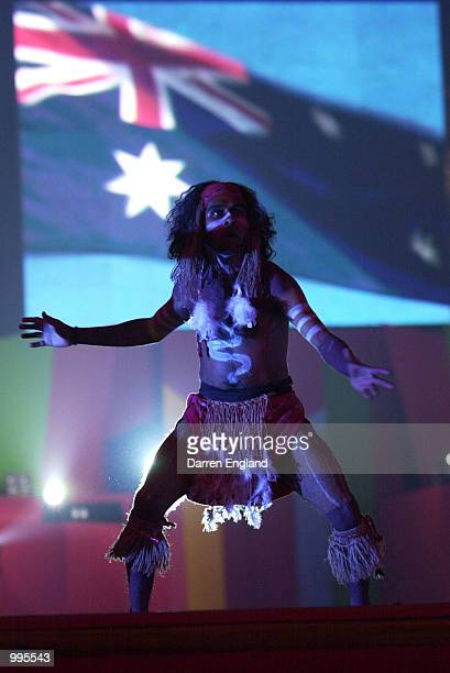Aboriginal dancers perform in front of the Australian flag during the Opening Gala at the Brisbane Entertainment Centre ahead of the Goodwill Games...