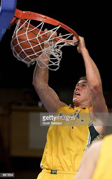 Ben Knight of Australia dunks during the Australia v Brazil match in the Mens Basketball held at the Brisbane Convention and Exhibition Centre at the...