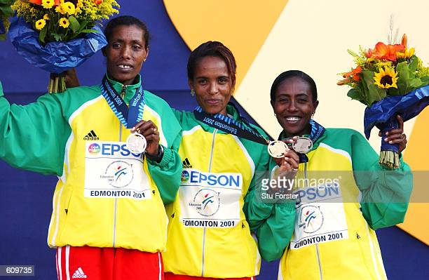 Berhane Adere Derartu Tulu and Gete Wami of Ethiopia receive their medals for the 10000 during the 8th IAAF World Championships in Edmonton Alberta...