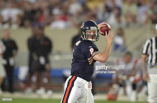 Cade McNown of the Chicago Bears looks for the open man during the NFL preseason game against the Cincinnati Bengals at Soldier Field in Chicago IL...