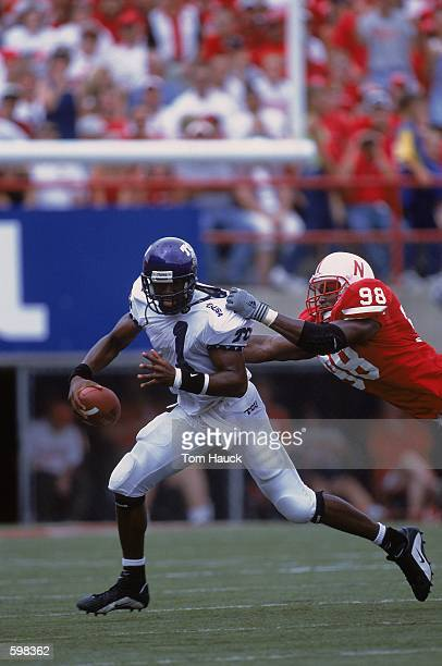Casey Printers of the Texas Christian Horned Frogs running with the ball while Demoine Adams tries to bring him down during the game against the...