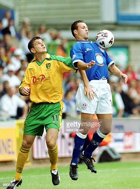 Chris Llewellyn of Norwich City challenges Lucas Neill of Millwall during the Nationwide Division One match between Millwall and Norwich City at The...