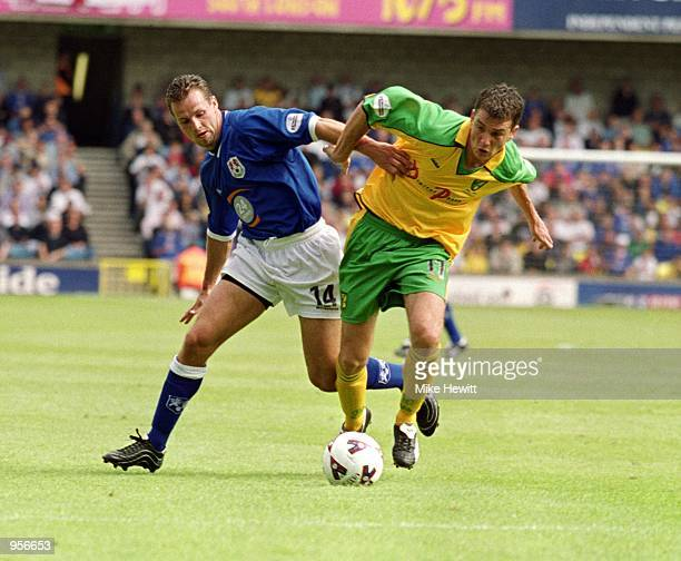 Chris Llewellyn of Norwich City takes the ball past Lucas Neill of Millwall during the Nationwide League Division One match played at The New Den in...