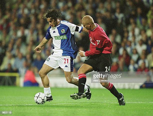 Corrado Grabbi of Blackburn Rovers holds off Wes Brown of Manchester United during the FA Barclaycard Premiership match played at Ewood Park in...
