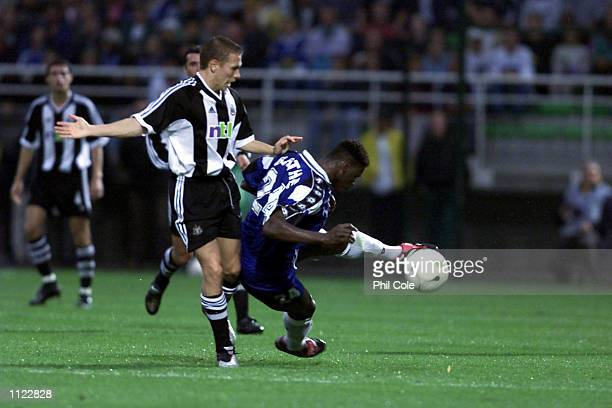 Craig Bellamy of Newcastle challenges Braaja of Troyes in the Intertoto Cup Final First Leg at the Stade de L''Aube in Troyes France DIGITAL IMAGE...