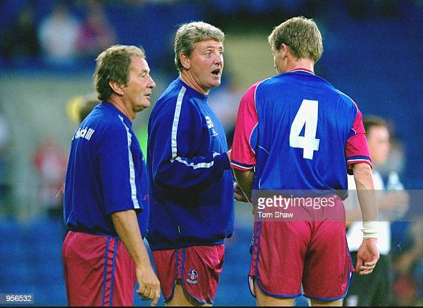 Crystal Palace manager Steve Bruce talks to his assistant Steve Kember and Dean Austin of Crystal Palace during the pre-season friendly match against...