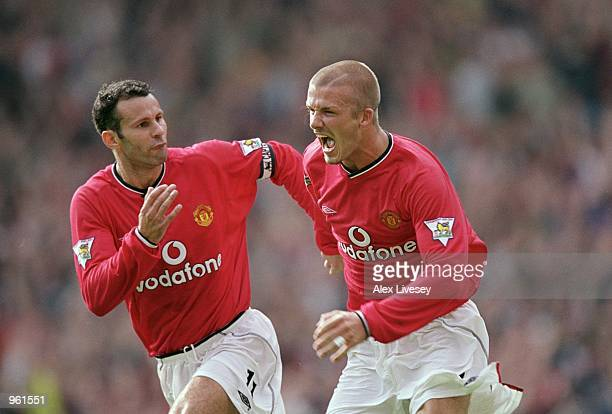 David Beckham of Manchester United celebrates scoring a freekick with team mate Ryan Giggs during the FA Barclaycard Premiership match against Fulham...